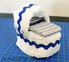 Baby Bassinet Diaper Cake Tutorial. This one isn't as decorated as others I've seen, but it comes with instructions!
