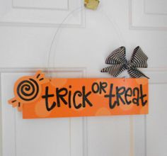 Trick or Treat Halloween polka dot sign with candy. $19.95, via Etsy.