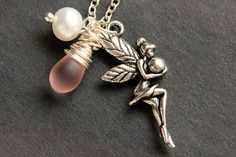Silver Fairy Charm Necklace. Silver Faery Necklace with Glass Teardrop and Fresh Water Pearl. Handmade Jewelry. by StumblingOnSainthood from Stumbling On Sainthood. Find it now at http://ift.tt/1TlkUGK!