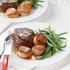 Steak and Scallops with Champagne-Butter Sauce Recipe Main Dishes with beef tenderloin steaks, salt, cracked black pepper, sea scallops, pink peppercorns, olive oil, champagne, fresh lemon juice, shallots, butter