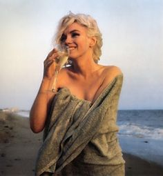 Marilyn drinking champagne on Santa Monica Beach, by George Barris 1962