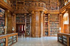 The Helikon Library in Festetics Palace, Keszthely, Hungary. Note the doorway concealed in the panelling, probably leading to a sprial staircase to the gallery level. I've been through the castle many times and never tire of it. Hidden panels everywhere!