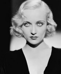 Carole Lombard Curls    Use heat curlers:    After heating the curlers, divide hair into four sections-2 on the left and right side and one in the back. Then rolled your hair under and all the way up to the root. Keep your hair parted to the side when you roll the hair. The let the curlers sit in your hair for 30 minutes before unrolled them.