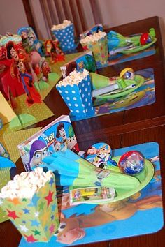 Great Toy Story Party Table - will use some pop corn boxes to fill up with various foods