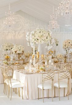 covered with soft blush linens and lush arrangements of ivory florals dripping with crystals. Gold accents added a touch of glamour to the space by way of guest chairs, candelabras, glassware, and vases.