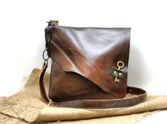 Asymmetrical Leather Bag - Slouchy Leather Messenger - Hobo Leather Satchel with Antique Skeleton Key - Pirate Bag by DivinaDenuevo on Etsy https://www.etsy.com/listing/187457548/asymmetrical-leather-bag-slouchy-leather