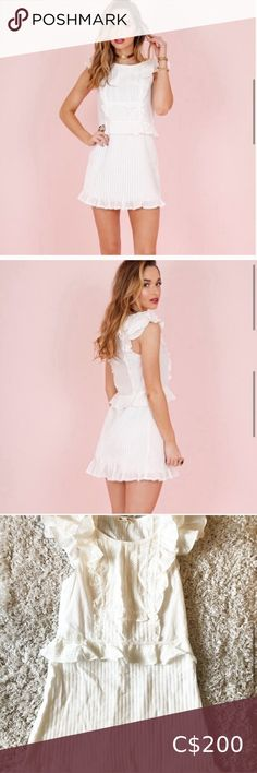 FOR LOVE AND LEMONS STARRY EYED MINI BRIDAL NWT Seeing it in your eyes. Pleated details, ruffle accents, and a feminine vibe define The Starry Eyed Dress from For Love & Lemons. With a fitted silhouette to show off some curves and the length leading way for your legs, it is easy to see why this dress brings out the sparkle in your eyes. Cotton blend Dry clean only Unlined Lace and tiered ruffle trim Pleated detail Hidden side zipper closure  $575 USD   NEW WITH TAG  Bridal collection For… For Your Legs, Starry Eyed, Online Thrift Store, Plus Fashion, Fashion Tips, Fashion Trends, For Love And Lemons, Ruffle Trim, Bridal Collection