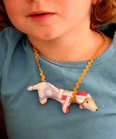 do softie necklaces other than dogs, theme of birthday party eg. fairy/robot/ etc. and place in take home bag or have them as craft made in plain calico and kids decorate for party craft