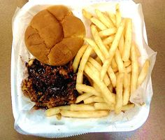 Pulled pork barbecue sandwich with fries from Alfred's on Beale (Street), a restaurant and nightclub in Memphis, TN.