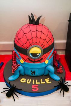 Amazing cake at a Minions superhero birthday party! See more party planning ideas at CatchMyParty.com!