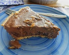 Dark Chocolate Tofu Pie (hubby might ACTUALLY eat this)  16 ounces soft tofu, drained and cubed  1 1/2 ounces semi-sweet chocolate baking chips  2 ounces powdered dark cacao, about 1/2 cup  1 tablespoon vanilla extract  4 tablespoons maple syrup  1/2 cup whole milk  Pinch salt  1 ready-made graham cracker pie crust  1 crumbled cookie, optional garnish