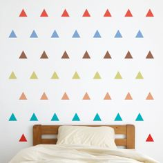 cheaper options for small walls in the #livingroom. Triangles of Trendiness Wall Decals--get them all in one, or two, colors for a mature look.