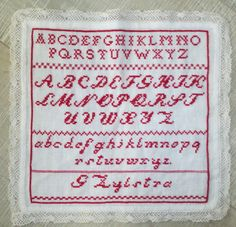 """Een oude letterlap gevonden waar enkele kruisjes op geborduurd waren.Hiervan mijn eigen """"oude"""" letterlap gemaakt. ontwerp van 1920"""
