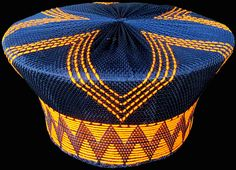 Zulu Hats are traditionally worn by the married Zulu woman of South Africa with brighly colored African designs. Zulu hats are called Isicholos in Zulu. African Hats, African Attire, African Clothes, African Dress, Zulu Women, African Fashion Traditional, African Princess, African Head Wraps, African Design