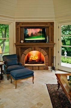 love the idea of adding trim around the firplace and tv to make it look like an antique...takes away from the glaring tv eye!