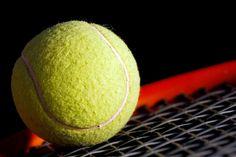 yellow tennis ball and tennis racket