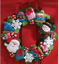 Bucilla Christmas Toys Wreath - Felt Applique Kit. Create Christmas traditions with heart-warming designs. Each kit contains: felt, beads, sequins, embroidery f