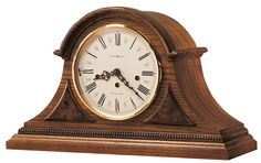 Worthington Mantel Clock. This mantel clock has gold accents and is beautiful in it's own way. Key-wound, Westminster chime Kieninger movement plays 1/4, 1/2, and 3/4 chimes accordingly with full chime and strike on the hour. An industry exclusive duel-ratchet winding arbor ensures safe movement winding.  Chime silence option and durable bronze bushings. Designed and Assembled in the USA.