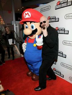 I love photos like this! Judas Priest's Rob Halford with Mario at the Nintendo World Store in NYC.  Read more: http://www.8-bitcentral.com/blog/2015/marioRescue.html#ixzz3b9YMubbf