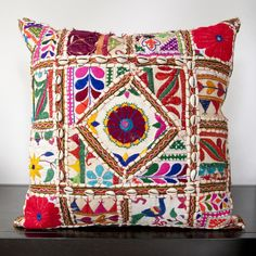 With a variety of designs and patterns, this floral pillow includes shells that accent this middle of the pillow. Colors of spring green, deep sea green, blue corn, raisin, magenta, venetian red, paprika, burnt orange, orange peel, sienna, charcoal gray, and putty accent this decorative pillow. This pillow contains a poly fill and a zipper closure. Add this 18