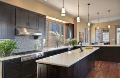 espresso kitchen cabinets with white granite top counter - Google Search