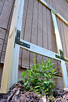 DIY garden frame used to hide garbage cans by @uglyducklingdiy using National Hardware