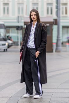 Tracksuit trousers do not equal scruffy, here's a case in point. Style with a crisp white shirt and long length coat for business-casj feels