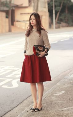 Mayo Wo models a tan sweater with burgundy tea-length skirt and some kitten heels with bows. See more fashion inspiration on her blog, mellowmayo.com.