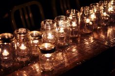 candles in mason jars. outdoor lighting.