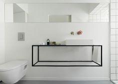 Revamp creates open, minimalist apartment with bold black accents - Curbedclockmenumore-arrow : A sleek, bright home in Tel Aviv