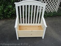 Repurposed crib into bench/toy box