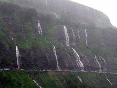 Malshej Ghat -  Monsoon weekend getaway from Pune. As you can see, numerous temporary waterfalls lure visitors from nearby cities.