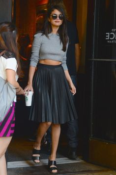 Selena Gomez; The leather midi skirt and cropped sweater is both edgy and flirty.