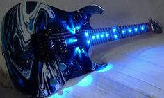 Blue swirl guitar with LED lights embedded into the neck and by the pick up!  I could dig it in the light or the darkness!  Light up, turn me on, rock me out!