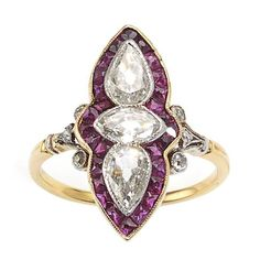 Antique Ruby Diamond Gold Ring. An antique ruby and diamond ring, with old-cut marquise and two pear shape diamonds, surrounded by French-cut calibré rubies, in millegrain edged rub over settings, with pierced gallery work below. Each shoulder is set with three eight-cut diamonds, mounted in gold. Circa 1890.