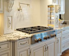 Built-in spice racks next to cook top.