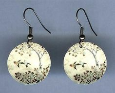 Flying Birds Earrings by design mosaic. A pair of birds fly by a tree. Made from polymer clay with surgical steel ear wires. The image is from antique Japanese Satsuma pottery. #handmade #jewelry