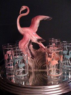 1950s pink flamingo figurine with a flamingo glass set. Photo by UrbaniteRetro via Flickr.