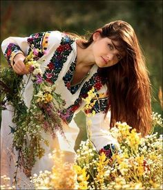 """slavic-roots: """" Ukrainian girl making a wreath out of flowers. Traditionally in Slavic nations flower wreaths were worn by maidens and unmarried women. Romanian Girls, Ethno Style, Luge, Folk Costume, People Around The World, Traditional Dresses, Ideias Fashion, Beautiful People, Celebrities"""