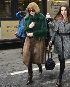 Snowy city: Anna Wintour walked through the sludge in a double fur jacket looking every inch the A-list star