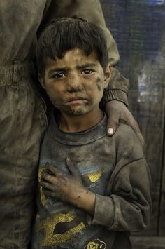 This young Hazara boy was photographed in Kabul, Afghanistan. This child is one of hundreds of millions of children in the world who work in factories, fields, mines, and quarries. McCurry