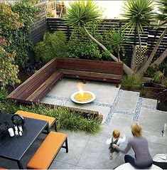 fire pit, benches, modern airy privacy fence, large concrete pavers with mixed small stones