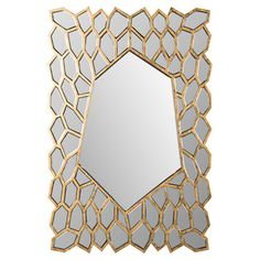 Defined by a honeycomb-inspired frame, this gold-finished wall mirror adds a chic touch to your entryway or powder room.  Product: