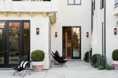 Staged by The Platform Experiment. West Hollywood spec house by Leigh Herzig, outdoor fireplace Hollywood Homes, West Hollywood, Porches, Courtyard Landscaping, Exterior Paint Colors, French Farmhouse, Color Stories, Outdoor Rooms, Outdoor Areas