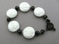 Black and white bracelet with flowershaped beads by janelson1965, $10.00