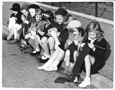 Very young English girls knitting, November 1939