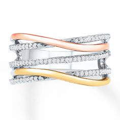 Ribbons of 10K rose and yellow gold flow across ribbons of sterling silver in this extraordinary ring for her. Diamonds totaling 1/5 carat in weight shimmer to complete the look. Diamond Total Carat Weight may range from .18 - .22 carats.