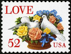 Flower and dove stamp issued in 1994 based on a Victorian photograph. Two white doves face each other in a basket filled with roses, carnations, and baby's-breath blossoms.