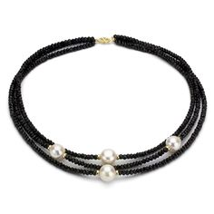<li>Add a touch of style to any wardrobe with a beautiful three-strand necklace</li>  <li>The creamy white freshwater pearls on the necklace elegantly offset the black onyx</li>  <li>This jewelry piece also features shining 14-karat yellow gold beads</li>