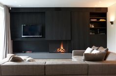 Panel slides to hide TV when not in use, built-in storage around modern fireplace in dark wood Open Fireplace, Fireplace Wall, Living Room With Fireplace, Fireplace Design, Living Tv, Home And Living, Racks Tv, Muebles Living, Interior Architecture